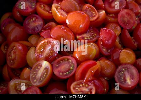 Sliced ripe juicy red cherry tomato close-up. - Stock Photo