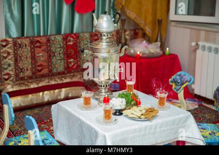Novruz holiday background . Semeni on vintage plate decorated . Samovar and teapot . Samovar on a background of - Stock Photo