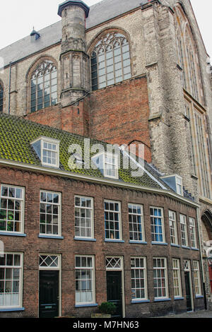 Medieval houses close to a medieval church in Dutch town of Leiden - Stock Photo