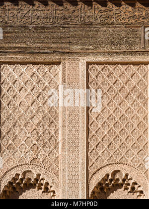 Ali ben Youssef Madrasa exterior islamic symbols, calligraphy and sacred geometry carved on the wall in Marrakesh, - Stock Photo