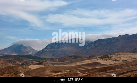 With a Mountain backdrop, the cultivated rolling foothills with their ancient Olive Groves and scattered Fincas - Stock Photo