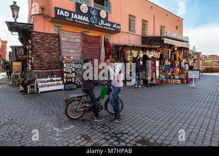 Marrakesh, Morocco - December 8, 2016: Unidentified people at a street in the medina of Marrakesh, Morocco. With - Stock Photo