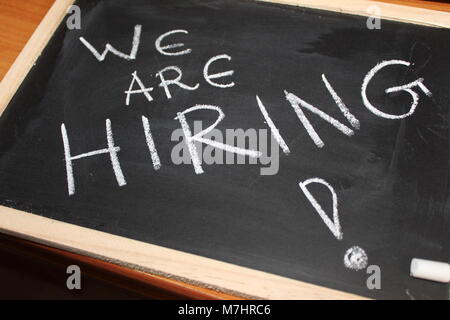 black board showing we are hiring - Stock Photo