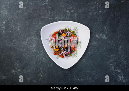 Asian salad with eggplants, tomatoes and garlic. - Stock Photo