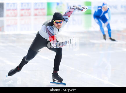 Amsterdam, Netherlands. 11th Mar, 2018. Haralds Silovs (L) of Latvia competes during the men's 1500m event of speed - Stock Photo