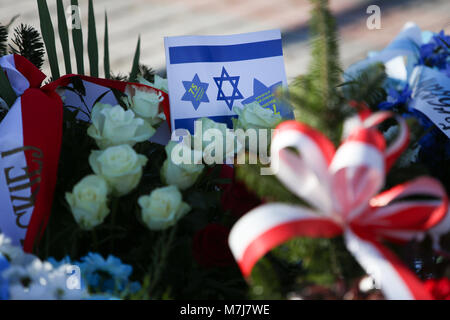 Krakow, Poland, Poland. 11th March, 2018. Israel flag among the wreaths on the monument to the victims from getto. - Stock Photo