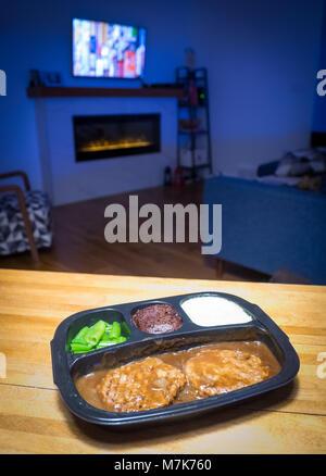 A Swanson Hungry-Man salisbury steak TV dinner (frozen dinner). - Stock Photo