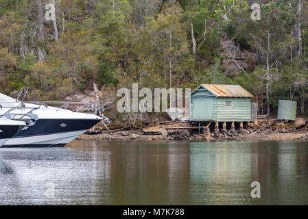 Boats moored at a marina in Roseville Chase (an upper part of Sydney Harbour) near an old timber boat shed. Australia - Stock Photo