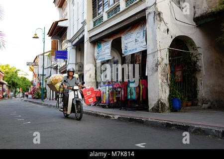 Motorbike and typical street scene at traditional Chinese shop houses in the UNESCO World Heritage zone of Georgetown - Stock Photo
