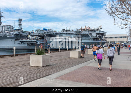SAN DIEGO, CALIFORNIA, USA - USS Midway Aircraft Carrier and maritime museum berthed on the waterfront in downtown - Stock Photo