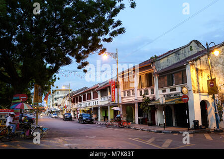 Street scene at traditional Chinese shop houses in the UNESCO World Heritage zone of Georgetown in Penang, Malaysia - Stock Photo
