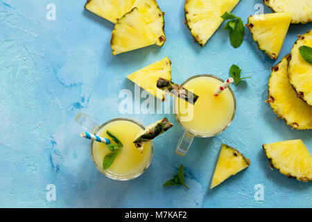 Homemade refreshing fruit beverage with pineapple, fresh vitamins. Cold summer drink. - Stock Photo