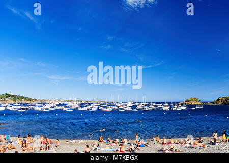 Cadaques, Spain - August 5, 2010: People at the beach in Cadaques on the bay in the Mediterranean Sea in summer, - Stock Photo