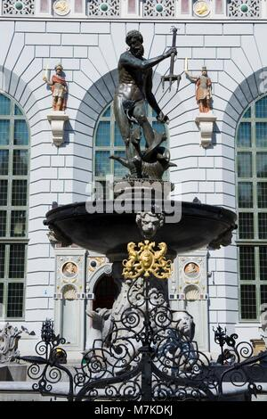 Neptune Fountain - symbol of Gdansk, located at Long Market against Artus Court, Poland - Stock Photo