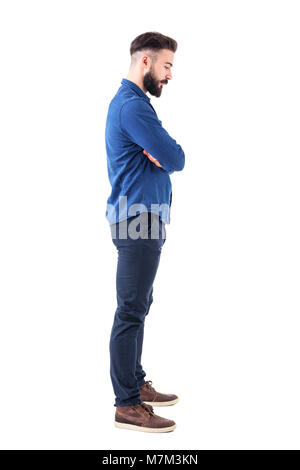 Profile view of sad man with bent down head and crossed arms looking down. Full body isolated on white background. - Stock Photo