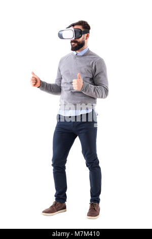 Smart casual business man wearing and watching vr glasses with thumbs up gesture. Full body isolated on white background. - Stock Photo