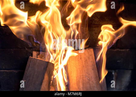 red yellow fire in the fireplace close-up. flames. Fire background - Stock Photo