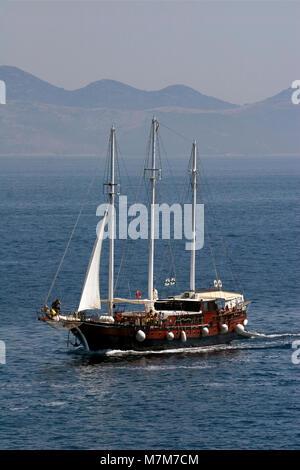 Old wooden clipper sails between Islands Brac and Hvar on Adriatic sea in Croatia - Stock Photo