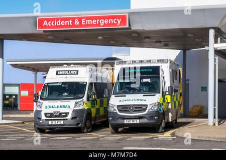 Two ambulances parked outside the Accident and Emergency department of Crosshouse University Hospital, Crosshouse, - Stock Photo