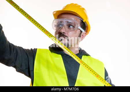 taking measurements with a meter, a man who wants to do a work without knowledge, work without experience. Do it - Stock Photo
