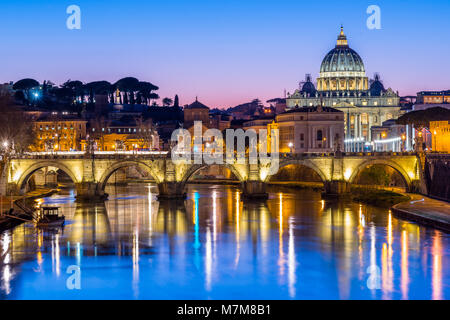 St Peter's Cathedral and Vatican city seen at dusk, over the river Tiber. Rome, Lazio, Italy. - Stock Photo