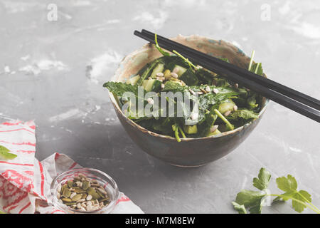 Green vegan kale, cucumber, sunflower seeds salad. Healthy vegetarian food concept. - Stock Photo