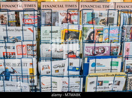 London, UK - March 10, 2018: Close up of British and international magazines and newspapers, including Arabic, for - Stock Photo