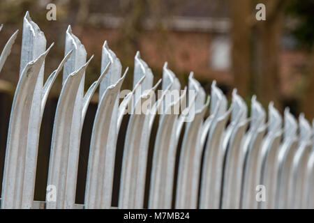 palisade fencing panels for security on site with razor sharp tips to prevent intruders and burglary or crime. anti - Stock Photo