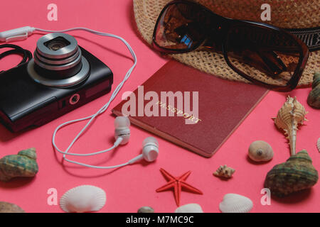 Passport, Seashells, Sunglasses, Photo Camera, Brown Hat, on Pink Background. Travel Concept. - Stock Photo