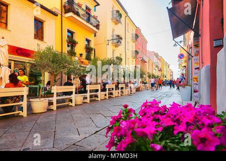 Olbia, Italy - September 11, 2017: People at street cafe in Corso Umberto Street in Olbia, Sardinia, Italy - Stock Photo