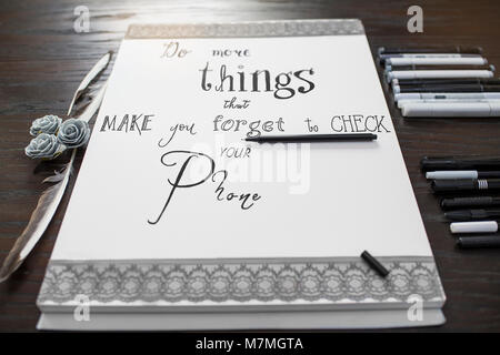 Handlettering with English Text - Do more things that make you forget to check your phone - Stock Photo