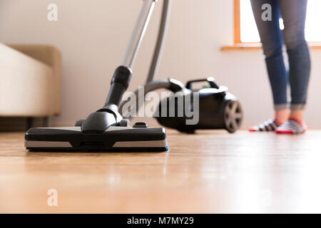 People, housework and housekeeping concept - happy woman with vacuum cleaner at home. Spring cleaning - Stock Photo