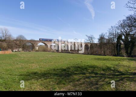 A Scotrail class 156 sprinter train crosses the viaduct at Stewarton (north of Kilmarnock) - Stock Photo