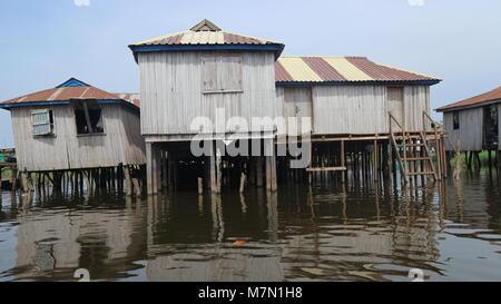Close up of stilt houses in Ganvie village on lake Nokoue in Benin, West Africa - Stock Photo