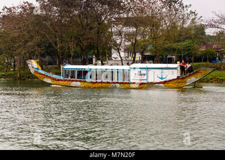 Dragon boat which can be hired by tourists sailing on the Perfume River, Hue, Vietnam - Stock Photo