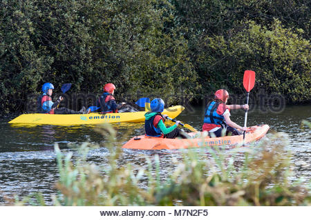 Group of young boys in kayaks on the lake in margam country park near port talbot south wales uk - Stock Photo
