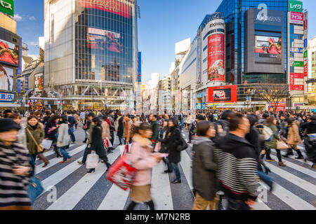 DECEMBER 24, 2012 - TOKYO, JAPAN: Pedestrians cross Shibuya Crossing, one of the busiest crosswalks in the world. - Stock Photo