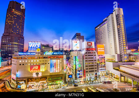 TOKYO, JAPAN - DECEMBER 24, 2012: Shibuya district cityscape at twilight. The district is one of the 23 special - Stock Photo