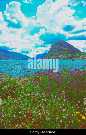 Garden park at the promenade of the luxurious resort in Lugano on Lake Lugano and Alps mountains, of Ticino canton, - Stock Photo