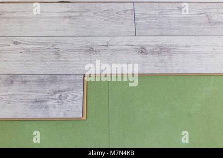 Installing laminate flooring. Install of laminate floor - Stock Photo