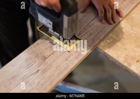 Installing Laminate Flooring Carpenter Cut Parquet Floor Board With