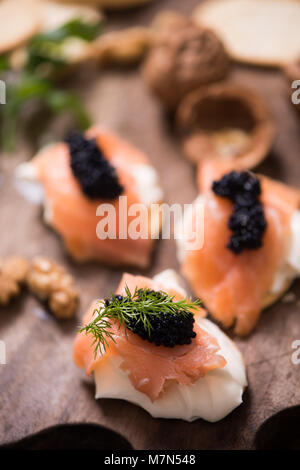 Canapes with smoked salmon and caviar - Stock Photo