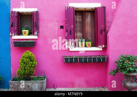 Purple home facade in Burano island, Venice, Italy, Europe - Stock Photo