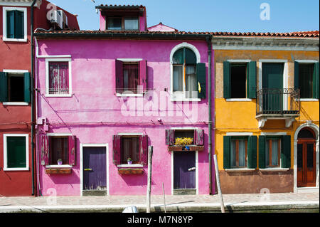 Colorful houses in Burano island, Venice, Italy, Europe - Stock Photo
