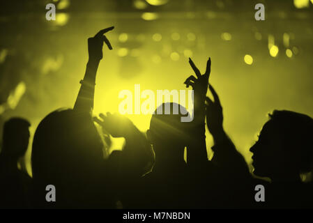 Hands of people in a nightclub - Stock Photo