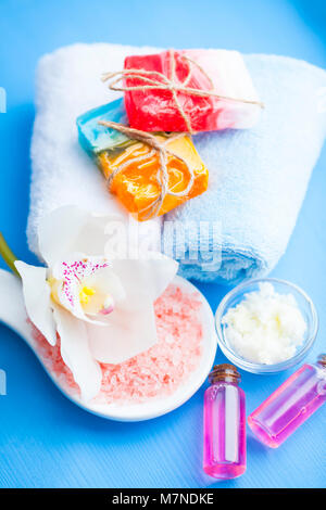 Spa and natural cosmetics concept. Set of skin and body care tools: shea oil, glass bottles with oil, sea salt, - Stock Photo