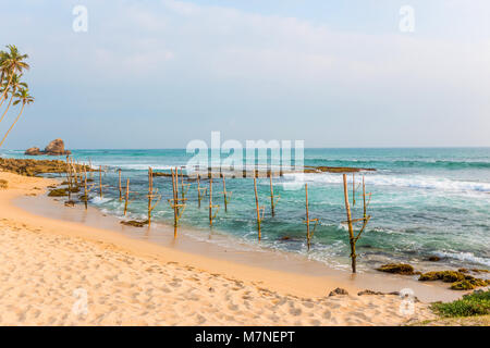 Beautiful seascape, boulders and palms - Stock Photo