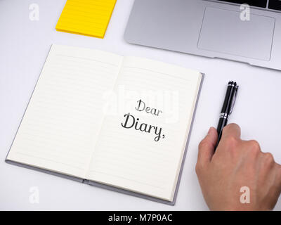 Dear diary written on notebook - Stock Photo