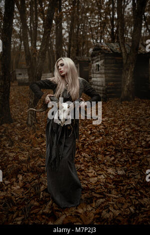 Witch in a long black dress - Stock Photo