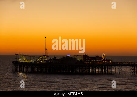 The Brighton Palace Pier, commonly known as Brighton Pier or the Palace Pier is a Grade II listed pleasure pier - Stock Photo